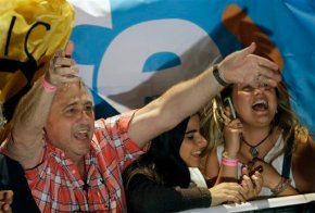 The Latest: Argentine opposition wins presidential election