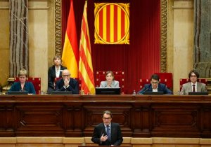 Regional acting president Artur Mas speaks at the Parliament in Barcelona, Spain, Monday, Nov. 9, 2015. The regional parliament of northeastern Catalonia is due to vote on a proposal by secessionist parties that hold a majority in the chamber to set up a road map for independence from Spain by 2017. The initiative defies Spain's central government, which considers it unconstitutional. (AP Photo/Manu Fernandez)