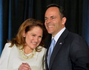 Kentucky Republican Gov.-elect Matt Bevin, right, and his wife Glenna react to the cheers of supporters during his introduction at the Republican Party victory celebration, Tuesday, Nov. 3, 2015, in Louisville, Ky. Bevin has defeated Democrat Jack Conway to become only the second Republican governor in the state in four decades. (AP Photo/Timothy D. Easley)