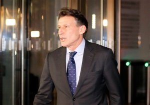 IAAF President Sebastian Coe walks out to give a statement to journalists outside his office in London, Friday, Nov. 13, 2015. Russia's track and field federation was provisionally suspended Friday by the sport's governing body. (AP Photo/Frank Augstein)