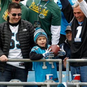 Virginia boy who lost father gets football from Cam Newton