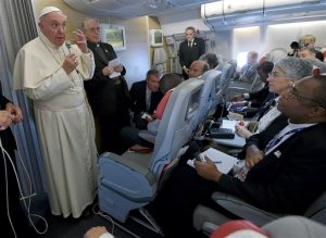 Pope Francis talks to journalists during a press conference he held aboard the flight on the way back to the Vatican, Monday, Nov. 30, 2015. Pope Francis traveled to Africa for a six-day visit that took him to Kenya, Uganda and the Central African Republic. (Daniel Dal Zennaro/Pool Photo via AP)