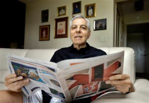 "In this Nov. 17, 2015, photo, Sal Natale looks over a Medicare brochure at his home in Seminole, Fla. Rising drug costs are starting to hit Medicare's popular prescription drug program, with many senior citizens looking at double digit premium increases next year. Natale, a retired dentist, said prescription premiums for him and his wife are going up about 30 percent next year, and he doesn't see a good alternative. ""I'm just going to grin and bear and hope it starts moderating,"" Natale said.  (AP Photo/Chris O'Meara)"