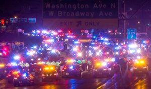 Demonstrators are surrounded and arrested by police after blocking a portion of Interstate 94, shutting down the northbound lanes, Monday, Nov. 16, 2015, in Minneapolis. The mayor of Minneapolis on Monday asked for a federal civil rights investigation into the weekend shooting of a black man by a police officer during an apparent struggle. Community members and activists called for a federal investigation, as well as for authorities to release video of the incident and the officer's identity. (Carlos Gonzalez/Star Tribune via AP)  MANDATORY CREDIT; ST. PAUL PIONEER PRESS OUT; MAGS OUT; TWIN CITIES LOCAL TELEVISION OUT