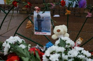 A portrait of 10 month Darina Gromova, a victim of a plane crash, is surrounded by flowers and toys attached to a fence at Dvortsovaya (Palace) Square in St.Petersburg, Russia, Wednesday, Nov. 4, 2015. A Russian official says families have identified the bodies of 33 victims killed in Saturday's plane crash over Egypt. The Russian jet crashed over the Sinai Peninsula early Saturday, killing all 224 people on board. Most of them were holidaymakers from Russia's St. Petersburg. (AP Photo/Ivan Sekretarev)