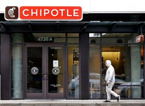 FILE - In this Nov. 2, 2015, file photo, a pedestrian walks past a closed Chipotle restaurant in Seattle. Washington state health officials say they have found no source for the E. coli outbreak related to Chipotle and the chain's Pacific Northwest restaurants could reopen later this week. Washington state epidemiologist Dr. Scott Lindquist says all the tests of food from Chipotle stores in Washington and Oregon came back negative for E. coli. (AP Photo/Elaine Thompson, File)