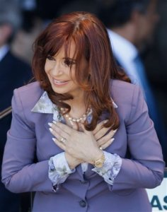 Argentina's President Cristina Fernandez places her hand on her chest as she acknowledges supporters after an event to inaugurate medical services at a public hospital in Moron, on the outskirts of Buenos Aires, Argentina, Wednesday, Nov. 25, 2015. The South American leader steps down Dec. 10 after eight years in the presidential office. Fernandez, 62, has said little about her future, other than repeatedly promising not to go away. (AP Photo/Ricardo Mazalan)