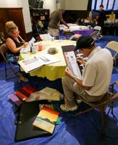 Homeless artists Romani Berlekov, left, and Frank Brescia paint at the Emmanuel Episcopal Church in Boston, Wednesday, Sept. 30, 2015. At the Boston church, many homeless participate in the Common Art program, which is designed not only to give them a place to stay warm, but an opportunity to express themselves, learn some life skills and gain self-esteem. (AP Photo/Charles Krupa)