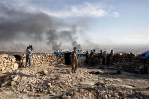 Smoke rises over Sinjar, northern Iraq from oil fires set by Islamic State militants as Kurdish Iraqi fighters, backed by U.S.-led airstrikes, launch a major assault on Thursday, Nov. 12, 2015. The strategic town of Sinjar was overran last year  by the Islamic State group in an onslaught that caused the flight of tens of thousands of Yazidis and first prompted the United States to launch the air campaign against the militants. (AP Photo/Bram Janssen)