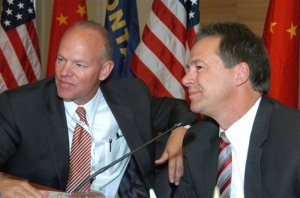 FILE - In this Aug. 25, 2015, file photo, Wyoming's Republican Gov. Matt Mead, left, and Montana's Democratic Gov. Steve Bullock appear at a coal industry event in Billings, Mont. in which officials from China and the U.S. took a major step toward an agreement to collaborate on technologies that would capture greenhouse gases produced from burning coal. The Powder River Basin along the Montana-Wyoming border has some of the largest coal reserves in the world. President Barack Obama's climate change plan to cut carbon-dioxide emissions puts pressure on the one Democratic governor in a coal-producing state seeking re-election next year, Montana's Steve Bullock. The Obama plan puts a big target on Bullock's back as he tries to avoid the fate of other Democrats tossed on the slag heap in the nation's coal belt. (AP Photo/Matthew Brown, File)