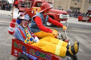 The Detroit Fire Department Clown Team zig-zags down Woodward Ave. during the 89th America's Thanksgiving Parade presented by Art Van in Detroit's Midtown on Thursday, Nov. 26, 2015. (Tanya Moutzalias/MLive Detroit via AP)