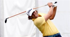 Lucas Glover watches he tee off on the first hole of the third round of the Sanderson Farms Championship golf tournament in Jackson, Miss., Sunday, Nov. 8, 2015. (AP Photo/Rogelio V. Solis)