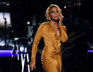 """FILE - In this June 28, 2015, file photo, Tamar Braxton performs at the BET Awards at the Microsoft Theater, in Los Angeles. Braxton has taken herself out of the competition on """"Dancing with the Stars,"""" series producer BBC Worldwide Productions said Wednesday, Nov. 11, 2015. (Photo by Chris Pizzello/Invision/AP, File)"""