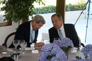 U.S. Secretary of State John Kerry, left, takes notes as he talks with Russian Foreign Minister Sergey Lavrov, at the G-20 summit in Antalya, Turkey, Sunday, Nov. 15, 2015.  The 2015 G-20 Leaders Summit is held near the Turkish Mediterranean coastal city of Antalya on Nov. 15-16, 2015. (Anadolu Agency via AP, Pool)