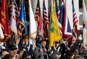 Honor guards carry the colors as they are retired at the conclusion of the annual National Veterans Day commemoration, Wednesday, Nov. 11, 2015, at Arlington National Cemetery in Arlington, Va., attended by President Barack Obama. (AP Photo/Manuel Balce Ceneta)
