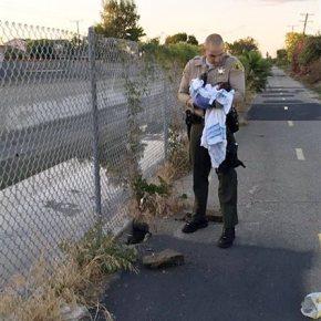 Sheriff's deputies rescue newborn found buried nearriver