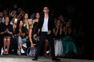 """FILE - In this Saturday, Sept. 12, 2015, file photo, designer Christian Siriano acknowledges the audience after his Spring 2016 collection show during Fashion Week in New York. Siriano, Kelly Osbourne and Tim Gunn help teens make it work on """"Project Runway Junior,"""" which premieres Thursday, Nov. 12, 2015, at 9 p.m. Eastern on Lifetime. (AP Photo/Jason DeCrow, File)"""