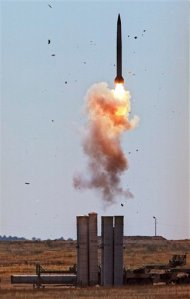 FILE - In this undated photo from files a S-300 air defense missile is launched in Ashuluk shooting range in southern Russia. The head of a Russian state-controlled industrial conglomerate says the contract for the delivery of S-300 air defense missile systems to Iran has been finalized. (AP Photo, File)