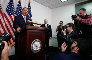 Outgoing House Speaker John Boehner of Ohio, accompanied by House Majority Whip Steve Scalise of La., right, talks with reporters on Capitol Hill in Washington, Tuesday, Oct. 27, 2015. House Republican leaders on Tuesday pushed toward a vote on a two-year budget deal despite conservative opposition, relying on the backing of Democrats for the far-reaching pact struck with President Barack Obama. In his last days as speaker, John Boehner was intent on getting the measure through Congress and head off a market-rattling debt crisis next week and a debilitating government shutdown in December. The deal also would take budget showdowns off the table until after the 2016 presidential and congressional elections, a potential boon to the eventual GOP nominee and incumbents facing tough re-election fights.  (AP Photo/Lauren Victoria Burke)