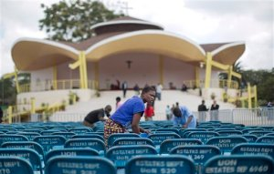A cleaner washes metal chairs to be used by guests at the site where the Papal Mass will take place, in Nairobi, Kenya Tuesday, Nov. 24, 2015. The Kenyan government has declared a national public holiday Thursday on the day that Pope Francis is due to celebrate mass on the grounds of the University of Nairobi with large crowds expected to flock to the event. (AP Photo/Ben Curtis)