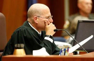 Fairfax county Circuit Court Judge Randy Bellows, studies a list of jury requests in the Charles Severance case at the Fairfax County Circuit County in Fairfax, Va., Thursday, Oct. 29, 2015. A jury is beginning deliberations Thursday in the triple murder trial of Severance, accused of shooting and killing three prominent Alexandria residents in their homes over the course of a decade. (AP Photo/Steve Helber, Pool)