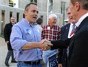 Republican gubernatorial candidate Matt Bevin, left, talks to people following the Greater Owensboro Chamber of Commerce's Red, White and Blue Picnic on the lawn of the Daviess County Courthouse, Thursday, Oct. 29, 2015 in Owensboro, Ky. (Jenny Sevcik/The Messenger-Inquirer via AP) MANDATORY CREDIT