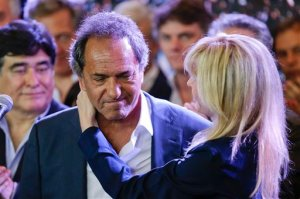 Daniel Scioli, the ruling party presidential candidate, is hugged by his wife Karina Rabolini after he delivered his concession speech to opposition candidate Mauricio Macri during Argentina's runoff presidential election in Buenos Aires,  Sunday, Nov. 22, 2015. Macri has won Argentina's historic runoff election, putting an end to the era of President Cristina Fernandez, who along with her late husband dominated the political scene and rewrote the country's social contract. (AP Photo/Ivan Fernandez)