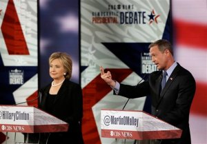 Martin O'Malley, right, makes a point as Hillary Rodham Clinton listens during a Democratic presidential primary debate, Saturday, Nov. 14, 2015, in Des Moines, Iowa. (AP Photo/Charlie Neibergall)