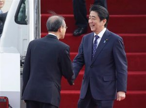 Japanese Prime Minister Shinzo Abe, right, shakes hands with South Korean first vice foreign minister Lim Sung-nam upon his arrival at Seoul Airport in Seongnam, South Korea, Sunday, Nov. 1, 2015. The leaders of South Korea, China and Japan are set to meet for their first summit talks in more than three years as they struggle to mend deep animosities centering on history and territory. (AP Photo/Ahn Young-joon)