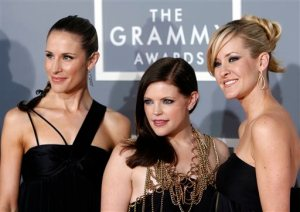 """FILE - In this Feb. 11, 2007, file photo, the Dixie Chicks, Emily Robison, left, Natalie Maines, center, and Martie Maguire, who earned five Grammy nominations, arrive for the 49th Annual Grammy Awards in Los Angeles. The Dixie Chicks are ready to party in the USA with a summer 2016 tour. The Grammy-winning group will kick off its """"DCX MMXVI World Tour"""" on June 1, 2016, in Cincinnati. It wraps in Los Angeles on Oct. 10, 2016. The group will visit more than 40 cities, including New York, Chicago, San Francisco, Detroit, Dallas and Toronto. The Dixie Chicks' North American tour will follow the group's European tour that begins in April. (AP Photo/Matt Sayles, File)"""
