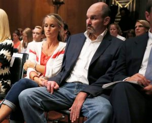FILE - In this Wednesday, June 25, 2014, file photo, former NFL football player Kevin Turner, right, who suffers from Lou Gehrig's disease, listens during testimony before the Senate Special Committee on Aging hearing regarding concussions and the long term effects of brain related sports injuries in Washington. The NFL will ask a U.S. appeals court to uphold a potential $1 billion plan to settle thousands of concussion lawsuits filed by former players on Thursday, Nov. 19, 2015. (AP Photo/Charles Dharapak, File)