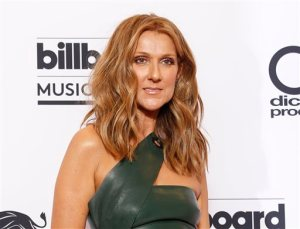 "FILE - In this May 17, 2015 file photo, Celine Dion poses at the Billboard Music Awards in Las Vegas. Dion and Lady Gaga have been added to a list of performers singing in honor of Frank Sinatra next month. The Recording Academy announced Tuesday that Zac Brown and Harry Connick, Jr. will also perform at ""Sinatra 100 - An All-Star GRAMMY Concert"" on Dec. 2 in Las Vegas. (Photo by Eric Jamison/Invision/AP, FIle)"