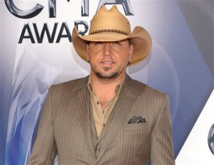 FILE - In this Nov. 4, 2015 file photo, Jason Aldean arrives at the 49th annual CMA Awards in Nashville, Tenn. A representative for Aldean said Tuesday, Nov. 10, that the country star dressed as rapper Lil Wayne as a Halloween costume after a picture surfaced of him with what looks like a painted face and a wig with dreadlocks. (Photo by Evan Agostini/Invision/AP, File)
