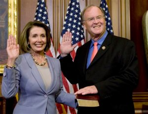 FILE - In this Jan. 6, 2009, file photo, House Speaker Nancy Pelosi of Calif., left, stands with Rep. Sam Farr, D-Calif., during a mock swearing in on Capitol Hill in Washington. Farr says he'll retire at the end of his term, ending a career in Congress spanning more than two decades. The 74-year-old made the announcement Thursday, Nov. 12, 2015, in Salinas, Calif. Farr represents the 20th congressional district which includes the Central Coast. He is the ranking member on the House Appropriations Subcommittee on Agriculture. (AP Photo/Haraz N. Ghanbari, File)