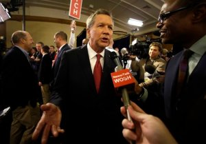 John Kasich talks to reporters in the spin room after the Republican presidential debate at the Milwaukee Theatre, Tuesday, Nov. 10, 2015, in Milwaukee. (AP Photo/Jeffrey Phelps)