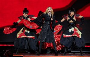 """FILE - In this Sept. 16, 2015 file photo, Madonna performs in concert at New York's Madison Square Garden in New York. Idris Elba is co-starring with Madonna on stage - not screen. The actor-musician will be the opening act during her """"Rebel Heart"""" tour stop Tuesday, Nov. 10, 2015, at the Mercedes Benz Arena in Berlin, Germany.  (Photo by Robert Altman/Invision/AP, File)"""