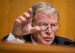 FILE - In this Sept. 29, 2015, file photo, Sen. James Inhofe, R-Okla., questions a witness during a hearing on Capitol Hill in Washington. Inhofe, an 81-year-old avid pilot who had quadruple heart bypass surgery two years ago, is trying to loosen medical exam requirements so that private pilots like him don't have to make so many doctors' visits to show they are fit to fly.  (AP Photo/Manuel Balce Ceneta, File)