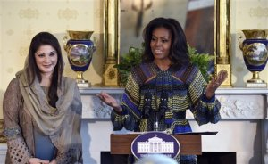 First lady Michelle Obama stands with Mariam Safdar, daughter of Pakistani Prime Minister Nawaz Sharif, speaks during an event in the Blue Room of the White House in Washington, Thursday, Oct. 22, 2015. Obama announced a new partnership to further adolescent girls' education in Pakistan as a part of the Let Girls Learn initiative that aims to help adolescent girls around the globe attend and complete school. (AP Photo/Susan Walsh)
