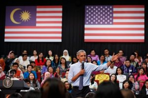 "U.S. President Barack Obama gestures as he speaks at the Young Southeast Asian Leaders Initiative (YSEALI) town hall meeting at Taylor's University in Kuala Lumpur, Malaysia, Friday, Nov. 20, 2015. Obama urged young people in predominantly Muslim Malaysia on Friday to reject the ""terrible vision"" that drove the Paris attacks, offering an alternative vision in which traditional cultures coexist with a diverse modern world. (AP Photo/Vincent Thian)"