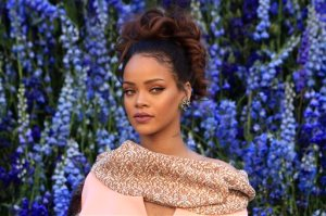 FILE -  In this Friday, Oct. 2, 2015, file photo, singer Rihanna poses before Christian Dior's Spring-Summer 2016 ready-to-wear fashion collection to be presented during the Paris Fashion Week, in Paris. Rihanna is taking her love of fashion, hair and makeup to the next level: She is opening a beauty agency in Los Angeles. With managing partner Benoit Demouy, Rihanna has launched Fr8me, which helps stylists, hairdressers and makeup artists book editorial and celebrity jobs.   (AP Photo/Thibault Camus, File)