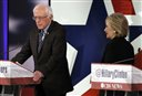 Hillary Rodham Clinton, right, walks by Bernie Sanders during a commercial break at a Democratic presidential primary debate, Saturday, Nov. 14, 2015, in Des Moines, Iowa. (AP Photo/Charlie Neibergall)
