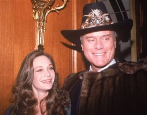 """FILE - In this Nov. 21, 1980, file photo, actress Mary Crosby, daughter of late entertainer Bing Crosby, and actor Larry Hagman, who plays J.R. Ewing in the popular TV series """"Dallas,"""" appear at a party in Los Angeles. Crosby starred as Kristin Shepard, the sister of Sue Ellen, and the woman who shot J.R. As many as 90 million viewers in the U.S. alone tuned to """"Dallas,"""" Nov. 21, 1980, to find out who shot J.R. Ewing. (AP Photo/Rasmussen, File)"""