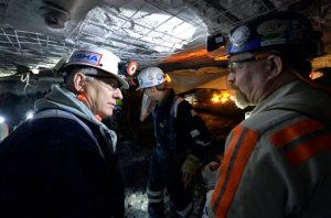 FILE- In this Jan. 13, 2015 file photo, Joe Main, left, Assistant Secretary of Labor for Mine Safety and Health, speaks with Jim Newton, a worker at the Gibson North mine in Princeton, Ind.  Main said that black lung is more widespread among coal miners than data shows. Beginning Feb. 1, 2016, the Mine Safety and Health Administration will require coal operators to increase the number of air samples taken in underground mines. The agency also will require miners working in the dustiest underground conditions to wear personal devices that give real-time readings on air quality. (AP Photo/Timothy D. Easley, File)