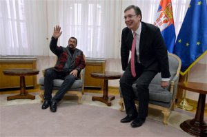 U.S actor and producer Steven Seagal, left, waves to reporters during a meeting with Serbian Prime Minister Aleksandar Vucic, in Belgrade, Serbia, Tuesday, Dec. 1, 2015. The veteran American actor and producer was on Tuesday offered to train Serbian special police forces in Aikido, a Japanese martial art, which he has been famous for in a series of his blockbuster movies. (AP Photo)