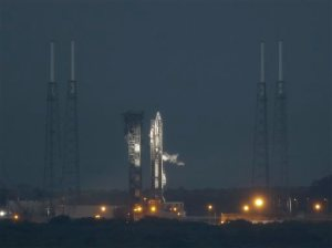 A United Launch Alliance Atlas V rocket stands ready shortly before a launch attempt was scrubbed due to poor weather conditions on launch complex 41at the Cape Canaveral Air Force Station, Thursday, Dec. 3, 2015, in Cape Canaveral, Fla. Another launch attempt is set for Friday. (AP Photo/John Raoux)