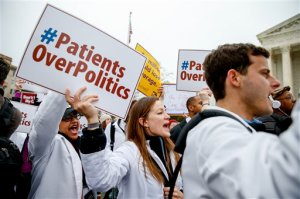 FILE - In this March 4, 2015 file photo, demonstrators chant during  health care rally outside the Supreme Court in Washington. The Supreme Court appears skeptical that state officials have the power to require health insurers to turn over reams of data revealing how much they pay for medical claims.  (AP Photo/Andrew Harnik, File)