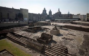Tourists visit the Templo Mayor archaeological site in Mexico City, Tuesday Dec. 1, 2015. Mexican archaeologists have discovered, at the archaeological site, a long tunnel leading into the center of a circular platform where Aztec rulers were believed to be cremated. The Aztecs are believed to have cremated the remains of their leaders during their 1325-1521 rule, but the final resting place of the cremains has never been found. (AP Photo/Eduardo Verdugo)