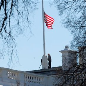 The Latest: Obama orders flags at half-staff after shooting