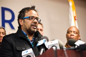 Farhan Khan, brother-in-law of one of the suspects involved in a shooting in San Bernardino, Calif., speaks during a news conference at the Greater Los Angeles Area office of the Council on American-Islamic Relations, in Anaheim, Calif. Multiple attackers opened fire on a banquet at a social services center for the disabled in San Bernardino on Wednesday, killing multiple people and sending police on a manhunt for suspects. (Matt Masin/The Orange County Register via AP) MAGS OUT; LOS ANGELES TIMES OUT; MANDATORY CREDIT