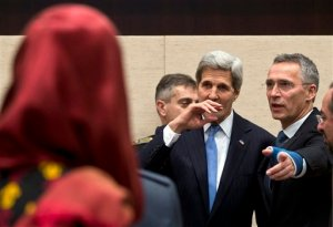 U.S. Secretary of State John Kerry, center, is guided by NATO Secretary General Jens Stoltenberg, second right, during a round table meeting of Resolute Support at NATO headquarters in Brussels on Tuesday, Dec. 1, 2015. U.S. Secretary of State John Kerry and other NATO foreign ministers meet Tuesday to discuss Russia, beefing up the alliance's southern defenses and whether to expand NATO by adding Montenegro to the NATO Alliance. (AP Photo/Virginia Mayo)